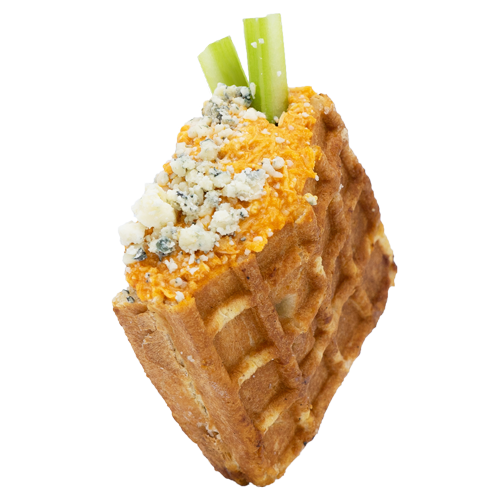 Buffalo Chicken stuffed waffle sprinkled with Blue Cheese Crumbles and Celery Stalks on a white background.