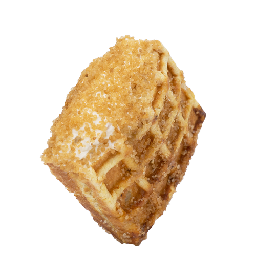 Maple Sugar and Cinnamon Spread stuffed waffle coated with granulated brown sugar on a white background.
