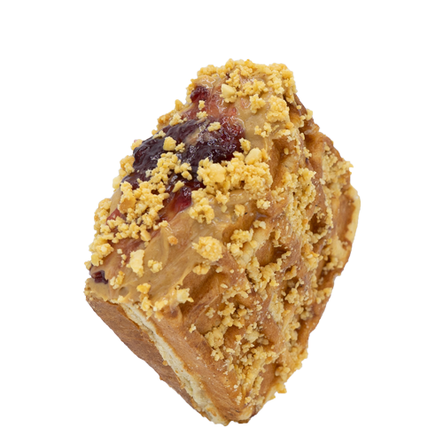 Peanut Butter and Jelly stuffed waffle coated with crushed peanuts on a white background.