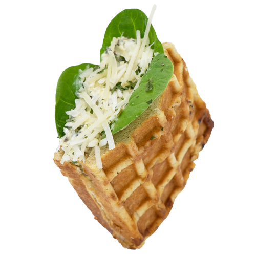 Spinach and Artichoke Spread stuffed waffle coated with Parm cheese and Oregano seasoning on a white background.